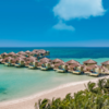 Discover Tropical Romance in 3 Overwater Bungalow Resorts on the Caribbean Sea